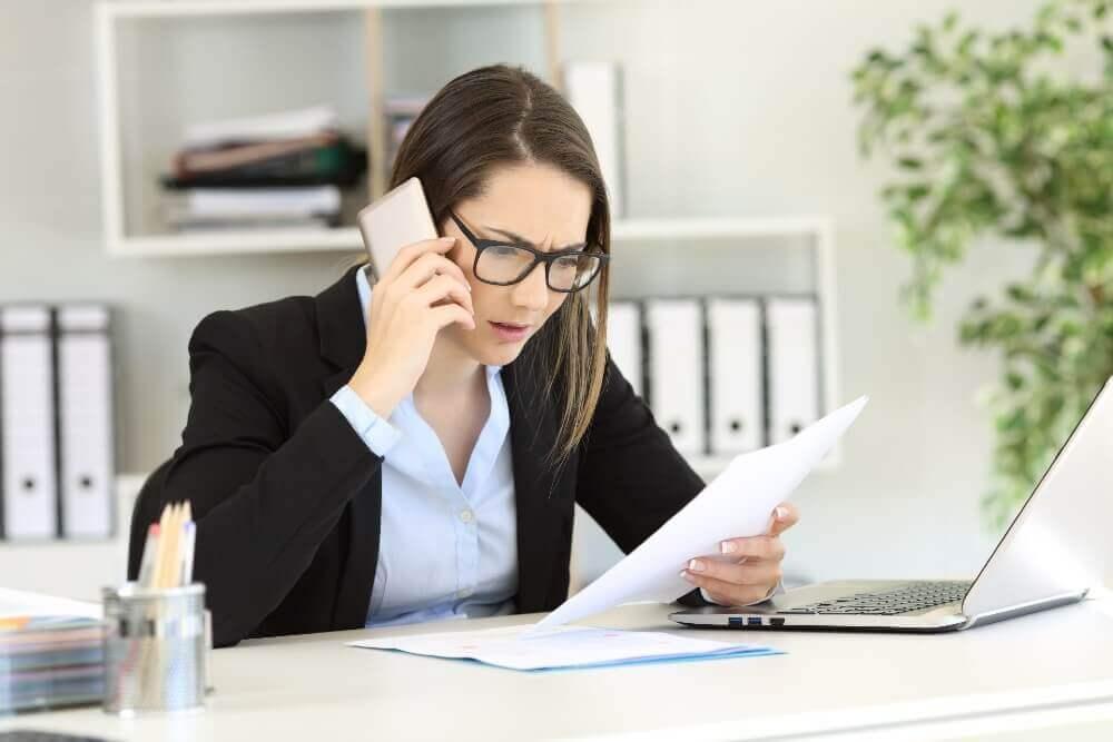 Woman fixing duplicat records